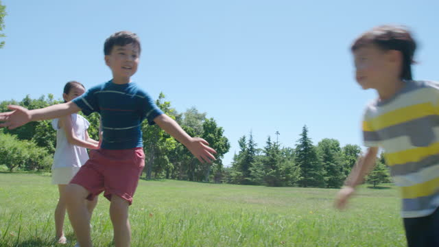 happy children playing on meadow,4k - playing stock videos & royalty-free footage