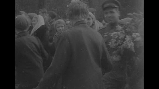 Happy children villagers and women greet Red Army liberators with kisses and flowers / Note exact day not known