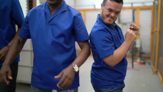 happy colleagues celebrating and dancing in industry - disability worker stock videos & royalty-free footage