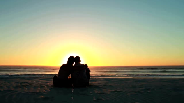 Happy couple at sunset on the beach