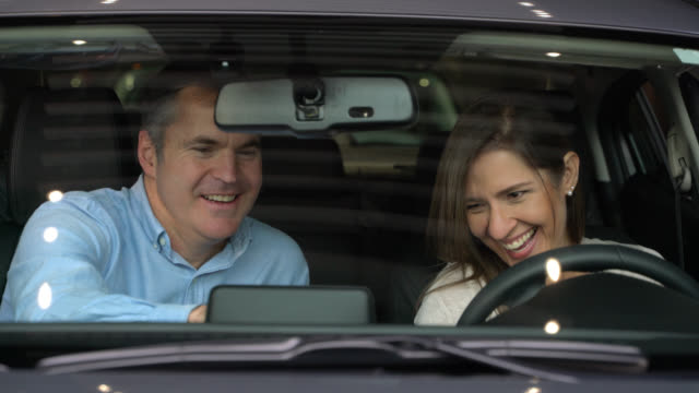 happy couple at the dealership looking at a car - test drive stock videos & royalty-free footage