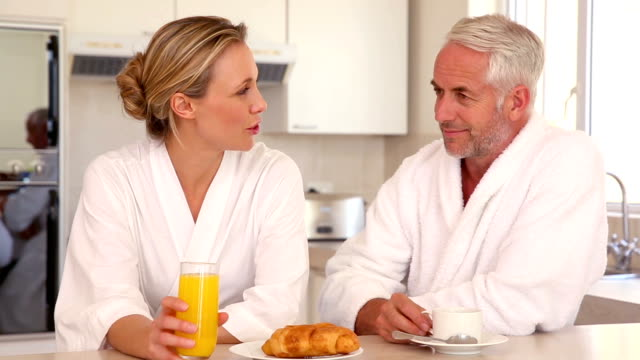 happy couple chatting at breakfast - ascorbic acid stock videos & royalty-free footage
