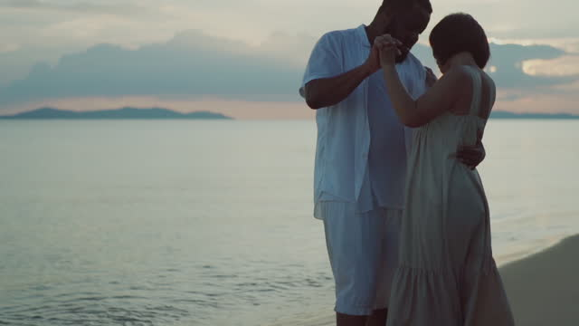 happy couple dancing  the beach. - hawaii islands stock videos & royalty-free footage