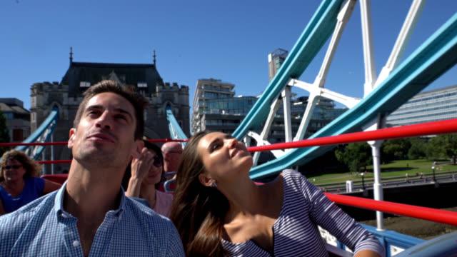 vídeos de stock e filmes b-roll de happy couple doing tourism on a bus across the city - tourist