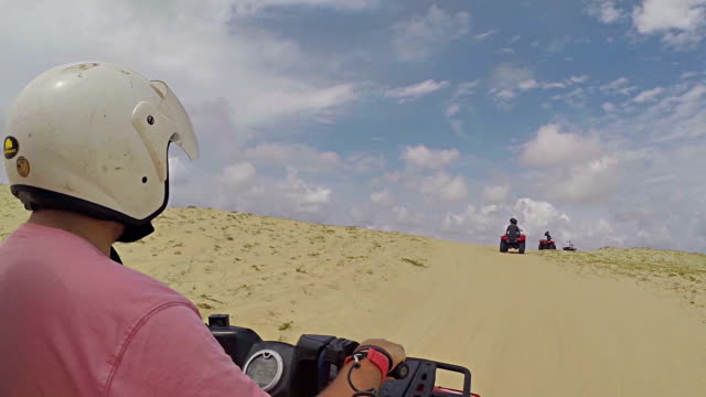 happy couple driving quad bike in the desert - quadbike stock videos & royalty-free footage