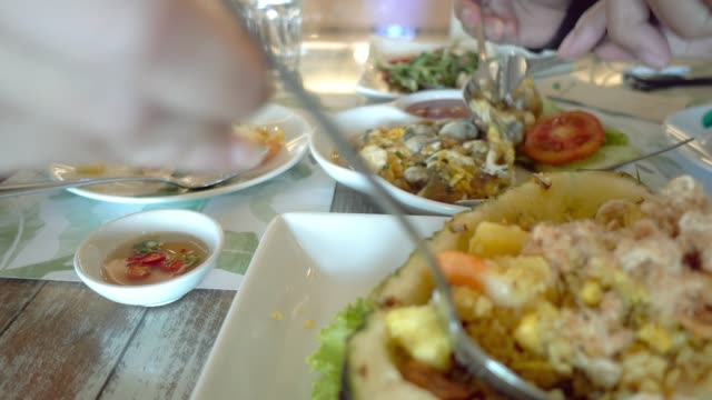 happy couple eating lunch in thai restaurant. - thai food stock videos and b-roll footage