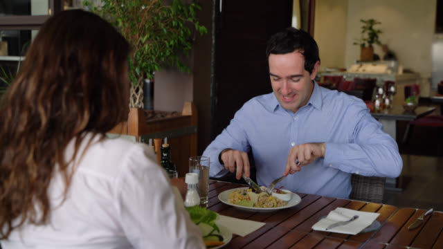 happy couple enjoying a healthy lunch at a luxury hotel having fun smiling - guest stock videos & royalty-free footage