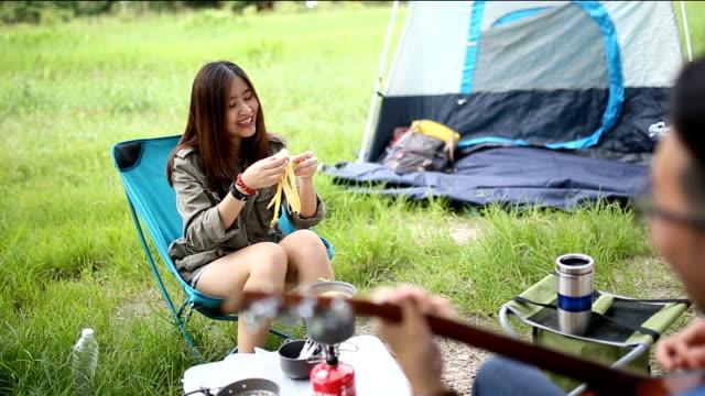 Happy couple enjoying camping Full HD.