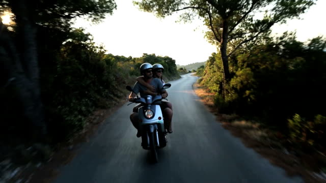 happy couple enjoying scooter adventure - motor scooter stock videos & royalty-free footage