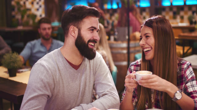 happy couple enjoying sitting in cafe - coffee drink stock videos & royalty-free footage