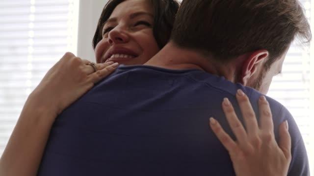 happy couple enjoying their romantic hug - mid adult couple stock videos & royalty-free footage