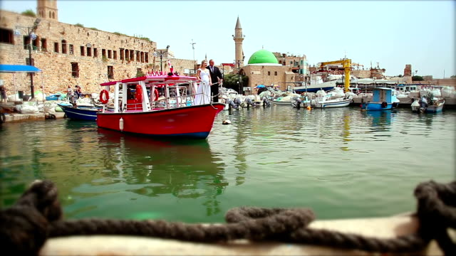 happy couple enjoys the view from boat deck - akko stock videos and b-roll footage