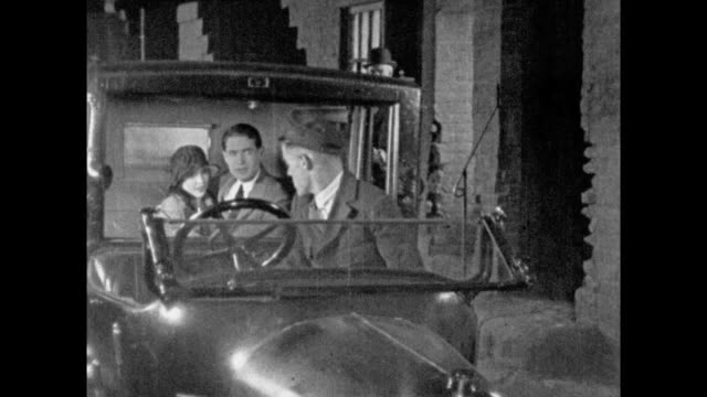 1925 happy couple get into the back of taxi cab and pull down privacy screen - 1925 stock videos & royalty-free footage