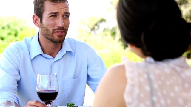 vídeos y material grabado en eventos de stock de pareja feliz teniendo una comida romántica junto - happy meal
