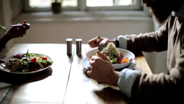 Happy couple having healthy dinner