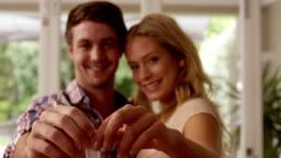 Happy couple holding keys together