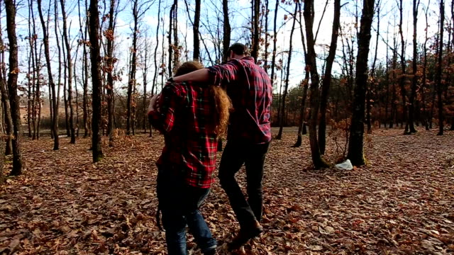 happy couple hugging and walking towards their tent. slow motion - snack stock videos & royalty-free footage
