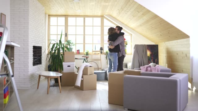 happy couple hugging in their new home - tenant stock videos & royalty-free footage