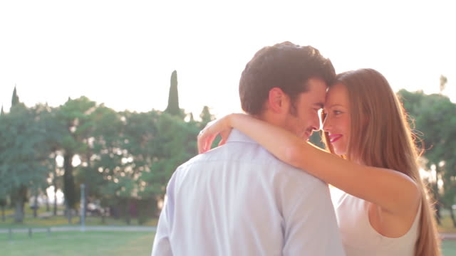 happy couple hugging outdoors - balkon stock-videos und b-roll-filmmaterial