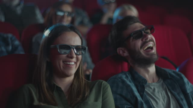 happy couple in 3d cinema - 3d glasses stock videos & royalty-free footage