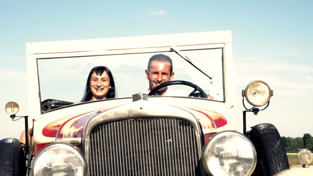 hd super slow-motion: happy couple in a vintage convertible car - 1930 stock videos & royalty-free footage