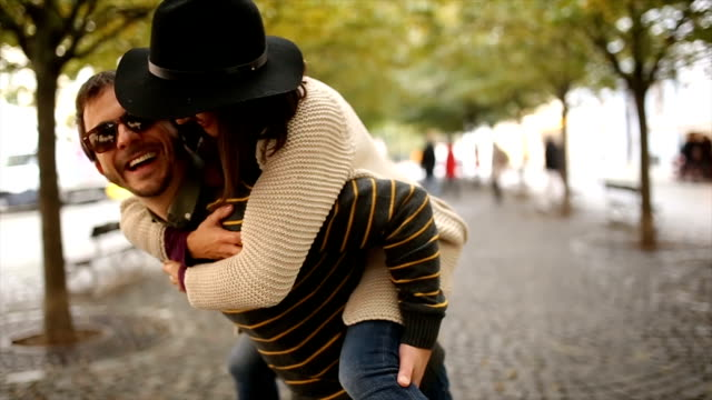 happy couple in autumn - piggyback stock videos & royalty-free footage