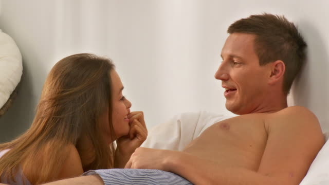 hd dolly: happy couple in bed - freedom stock videos & royalty-free footage