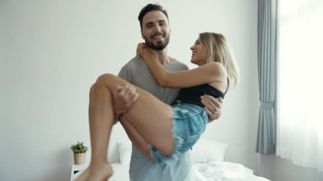 happy couple in bedroom - boyfriend stock videos & royalty-free footage