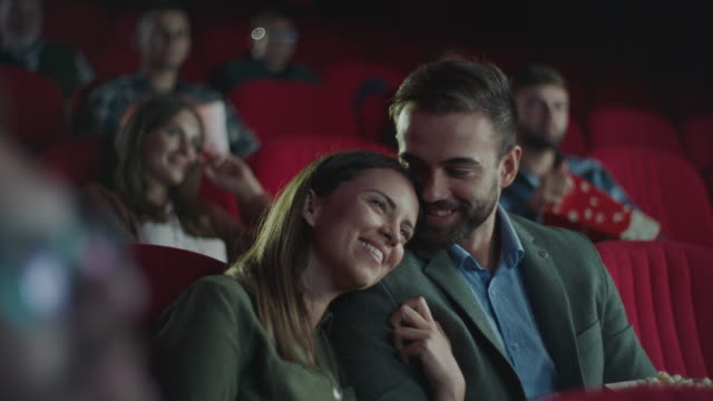 vídeos de stock e filmes b-roll de happy couple in cinema - film industry