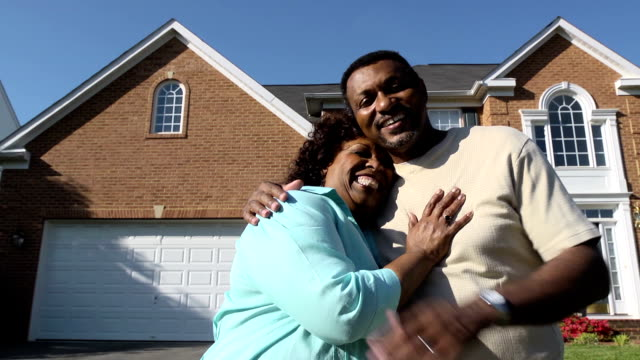 happy couple in front of home - in front of stock videos & royalty-free footage