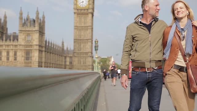 happy couple in love during a trip to london - clock tower stock videos & royalty-free footage