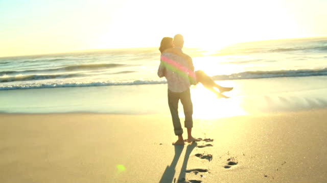happy couple in love on the beach - bonding stock videos & royalty-free footage