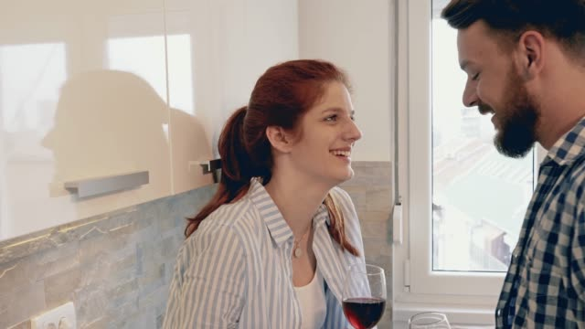 happy couple in love toasting and drinking wine in the kitchen. - forehead stock videos and b-roll footage