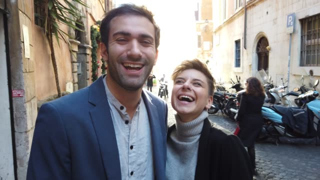happy couple in rome smiling at camera - southern european stock videos & royalty-free footage