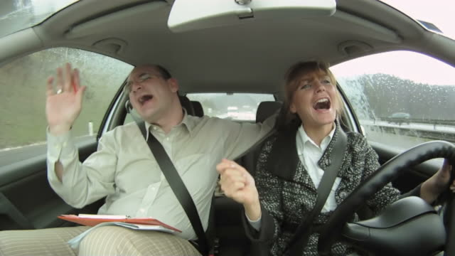 hd: happy couple in the car - singing stock videos & royalty-free footage