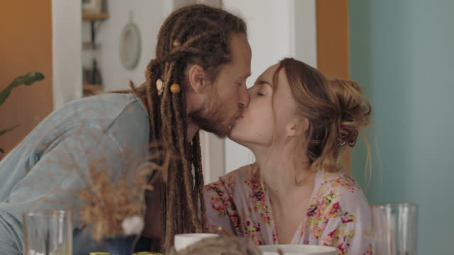 happy couple kiss and eat together at table - young couple stock videos & royalty-free footage