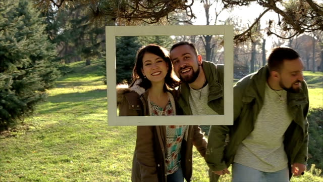 happy couple makes a unusual photography - photo shooting stock videos and b-roll footage