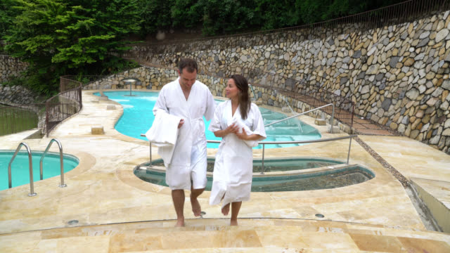 Happy couple on their vacation at an outdoor spa