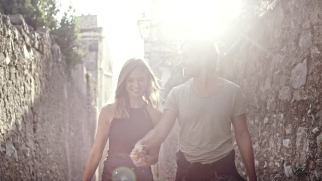 happy couple on vacations. old town's narrow streets - romance stock videos & royalty-free footage