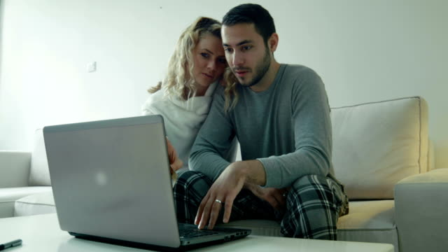 happy couple purchasing something on internet - blonde hair stock videos & royalty-free footage