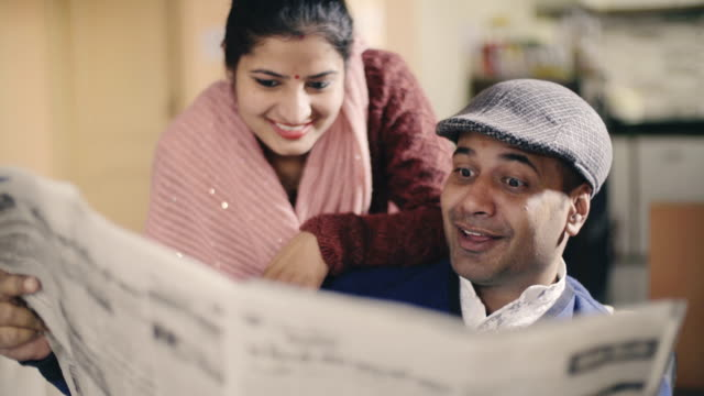 happy couple reading newspaper together. - leisure activity stock videos & royalty-free footage