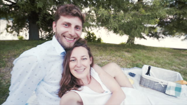 happy couple taking selfie. - picnic stock videos and b-roll footage