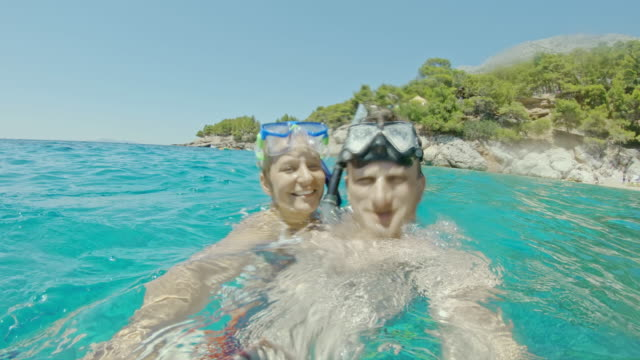 ms pov happy couple with snorkeling goggles in sunny adriatic sea,croatia - husband stock videos & royalty-free footage