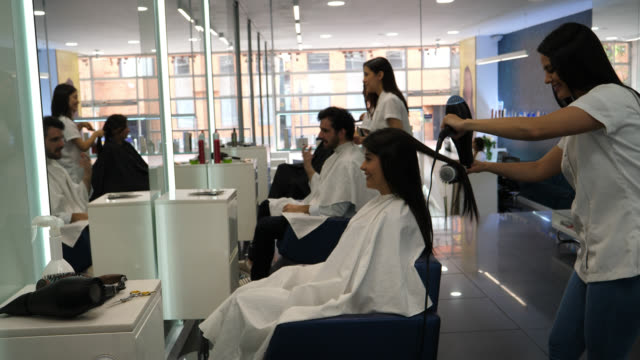 happy customers at the hair salon getting hairdo's - beauty salon stock videos & royalty-free footage