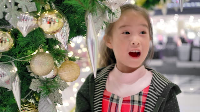 slo mo happy cute little girl in christmas festival - cosy stock videos & royalty-free footage