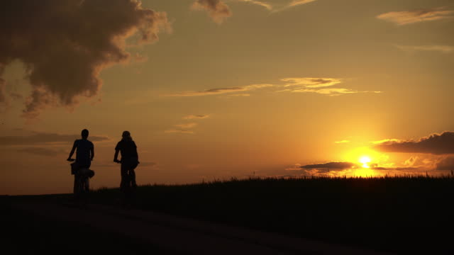 happy cyclists at sunset - mountain ridge stock videos & royalty-free footage