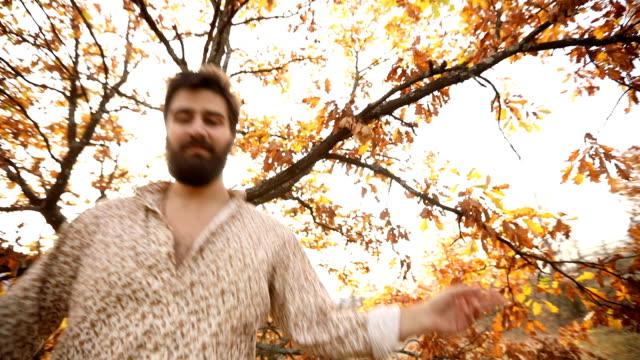 Happy dancing man in autumn