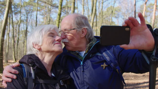 happy elderly couple taking self portrait in trip - active seniors stock videos & royalty-free footage