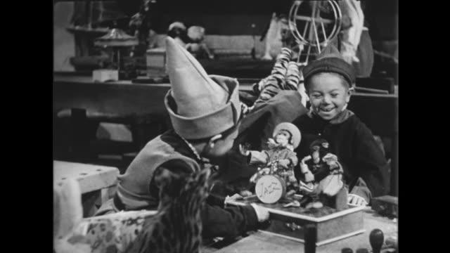 1941 Happy elves check toys before packing in Santa's sacks