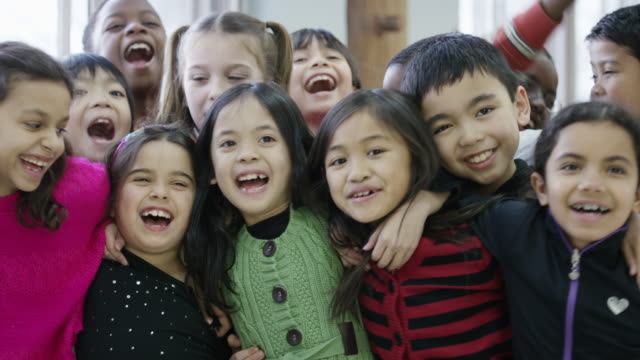 happy ethnic group of diverse third graders - multiracial group stock videos & royalty-free footage